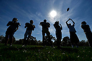 Members of the Foreman High School football team watch as teammates practice kickoff returns at Chopin Park, Friday, September 14, 2012 in Chicago.  Foreman football players have been holding unofficial practices with no coaches since the Chicago Public School's teachers went on strike Monday.  (AP)