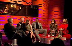 (left to right) Host Graham Norton with Tom Hanks, Maisie Williams, Anthony Joshua and First Aid Kit during filming of the Graham Norton Show at The London Studios, to be aired on BBC One on Friday.