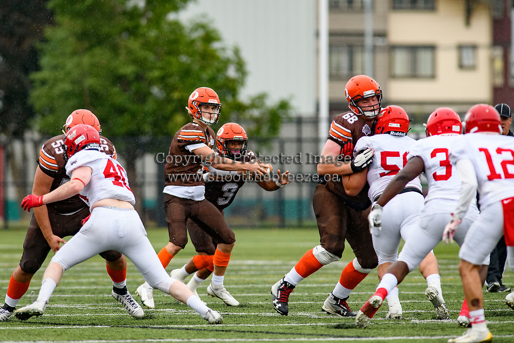 CHILLIWACK, BC - SEPTEMBER 11: Dominic Britton #5 hands the ball off to Malcolm Miller #3 of Okanagan Sun against the Westshore Rebels at Exhibition Stadium in Chilliwack, BC, Canada. (Photo by Marissa Baecker/Shoot the Breeze)