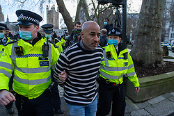 © Licensed to London News Pictures. 19/12/2020. London, UK. A protester is arrested in Parliament Square. Protesters have gathered in central London for an anti-lockdown demonstration. Photo credit: Peter Manning/LNP