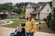 """PELHAM, AL – MARCH 30, 2020: Susan Lee, 43, spends time with her 12 year-old daughter, Alyssa, outside their home in the Keenland Valley neighborhood. As a special education teacher with 23 years of experience in Shelby County schools, Lee has found it challenging to establish a rhythm at home with her own special needs child, in the midst of school closures due to coronavirus. """"It obviously makes things hard,"""" Lee said. """"As teachers, we want what's best for our students. And as parents we want the same, but we can't provide that right now."""" Lee's daughter was born with RETT syndrome – a genetic neurological disorder that impairs most basic functions. """"Like most kids with special needs, she likes a routine,"""" Lee said. """"So it's stressful.It's required a lot of thinking outside the box. But the kids are stressed too. In their undeveloped brains, they're struggling more than we think they are."""""""