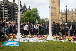 Parliament Square, Westminster, London, June 17th 2016. Following the murder of Jo Cox MP a vigil is held as friends and members of the public lay flowers, light candles and leave notes of condolence and love in Parliament Square, opposite the House of Commons. PICTURED: A general view of the scene as people arrive of the 7pm vigil