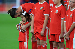 Wales' Gareth Bale with his daughter Alba Violet before the League B, Group four match at Cardiff City Stadium. PRESS ASSOCIATION Photo. Picture date: Thursday September 6, 2018. See PA story SOCCER Wales. Photo credit should read: Mike Egerton/PA Wire. RESTRICTIONS: Editorial use only, No commercial use without prior permission.