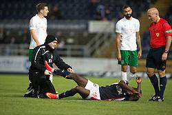 Falkirk's Botti Biabi injured. <br /> Falkirk 1 v 0 Hibernian, Scottish Championship game played 6/12/2014 at The Falkirk Stadium .
