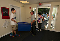 Samuel Avard and Raymond Townsend assist families and students moving into the Apple Ridge student apartments at LRCC on Sunday morning.  (Karen Bobotas/for the Laconia Daily Sun)