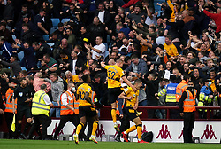 Wolverhampton Wanderers' Conor Coady (right) celebrates scoring his sides second goal to level the score at 2-2 during the Premier League match at Villa Park, Birmingham. Picture date: Saturday October 16, 2021.