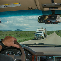 A driver navigates US Highway 191 through Phillips County, Montana.