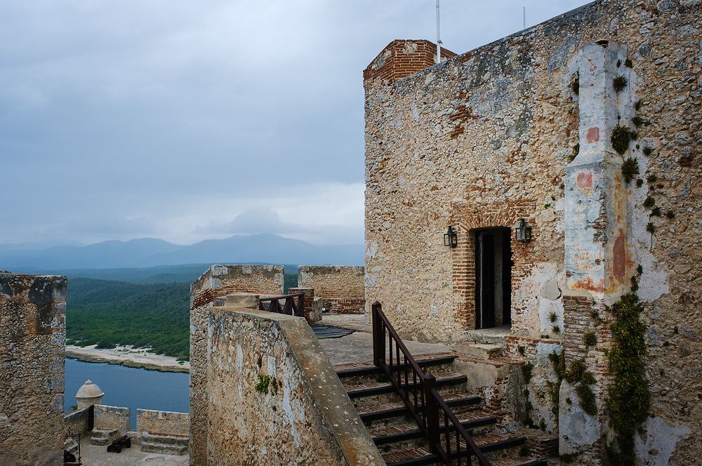 SANTIAGO DE CUBA, CUBA - CIRCA JANUARY 2020: San Pedro de la Roca Castle. The large fort was built to defend the important port of Santiago de Cuba. The design of the fortification was based on Italian and Renaissance architecture. This place is a designated Unesco World Heritage Site.