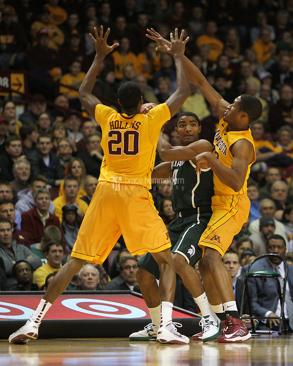 Dec 31, 2012; Minneapolis, MN, USA; Michigan State Spartans guard Gary Harris (14) is trapped by Minnesota Golden Gophers guard Austin Hollins (20) and forward Rodney Williams during the first half at Williams Arena. Mandatory Credit: Brace Hemmelgarn