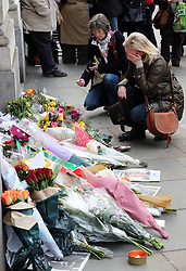 Mourners lay flowers outside South Africa House in London,  Friday, 6th December 2013, following the death Nelson Mandela, Picture by Stephen Lock / i-Images
