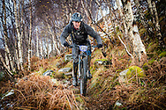 Steven Macvickar finds his way through the trees of stage one of Kinlochleven Enduro.