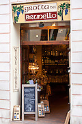 Grotta del Brunello wine shop in Costa di Piazza Garibaldi in old hill town of Montalcino, Val D'Orcia, Tuscany, Italy