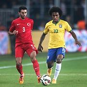Turkey's Ismail Koybasi (L) and Brazil's Willian (R) during their a international friendly soccer match Turkey betwen Brazil at Sukru Saracoglu Arena in istanbul November 12, 2014. Photo by Aykut AKICI/TURKPIX
