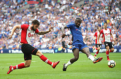 Southampton's Charlie Austin (left) has a shot on goal during the Emirates FA Cup semi-final match at Wembley Stadium, London.