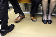 feet of business men and woman during commute Tokyo Japan