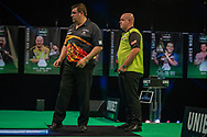 Jose de Sousa (Portugal) and Michael van Gerwen (Netherlands) during the Betway Premier League Darts Night Eight at Marshall Arena, Milton Keynes, United Kingdom on 21 April 2021