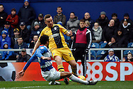 Jamie O'Hara of Fulham takes a shot on target whilst under pressure from James Perch of QPR. Skybet football league championship match, Queens Park Rangers v Fulham at Loftus Road Stadium in London on Saturday 13th February 2016.<br /> pic by Steffan Bowen, Andrew Orchard sports photography.