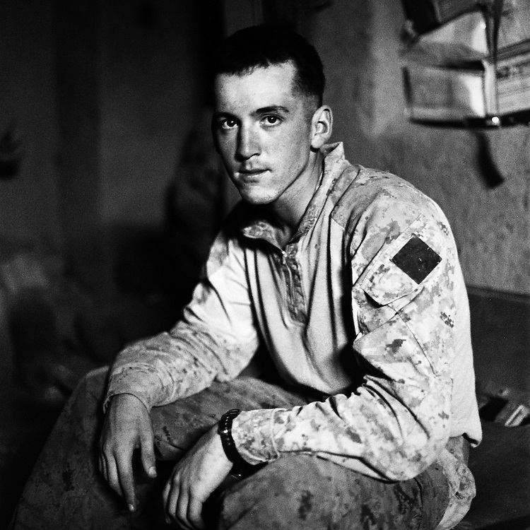 """Location:<br /> Patrol Base Fires, Sangin District, Helmand Province, Afghanistan<br /> <br /> Unit: <br /> 3rd Squad, 1st Platoon, Bravo Company, 1st Battalion, 5th Marines<br /> <br /> Name and Rank: Lance Corporal David Ortega<br /> <br /> Age: 20<br /> <br /> Hometown: Beaumont, California<br /> <br /> Why did you join the Marines?<br /> <br /> """"I have a lot of family that's in the Marine Corps . . . my mom's worked on the base for so long that whenever she took me to work, I would just always look up to the Marines and I was like, I'm gonna become one of them someday.""""<br /> <br /> Describe Sangin for someone back home:<br /> <br /> """"The Helmand River that runs through makes it look nice, and then the green zone makes it look even better. I was coming here thinking it was gonna be all desert, and then when I seen all the trees and all the poppy and the flowers from the poppy, I thought it looked like a really neat place to be.""""<br /> <br /> What do you think about the Taliban?<br /> <br /> """"The Taliban fighters, they're not stupid. A lot of people say they're stupid but they're good at what they do. They observe us, they watch our routes and they watch everything that we do for awhile, and then they hit us with IEDs on routes that we take or treelines that we take constantly, and they have complex ambushes in areas that we walk normally.""""<br /> <br /> What is the worst part about your job?<br /> <br /> """"The hardest part of what we do out here is probably watching our friends get hurt or pass away.""""<br /> <br /> Do you think the emotional weight of what you've experience will catch up to you?<br /> <br /> """"I think they try to keep our minds off of it as much as they can 'cause we're always constantly working out here, but when we go home it might be a different story, it might not.""""<br /> <br /> Is it weird to think you were just in high school two years ago?<br /> <br /> """"I knew what I was doing when I went to go talk to the recruiter because it was a time of w"""