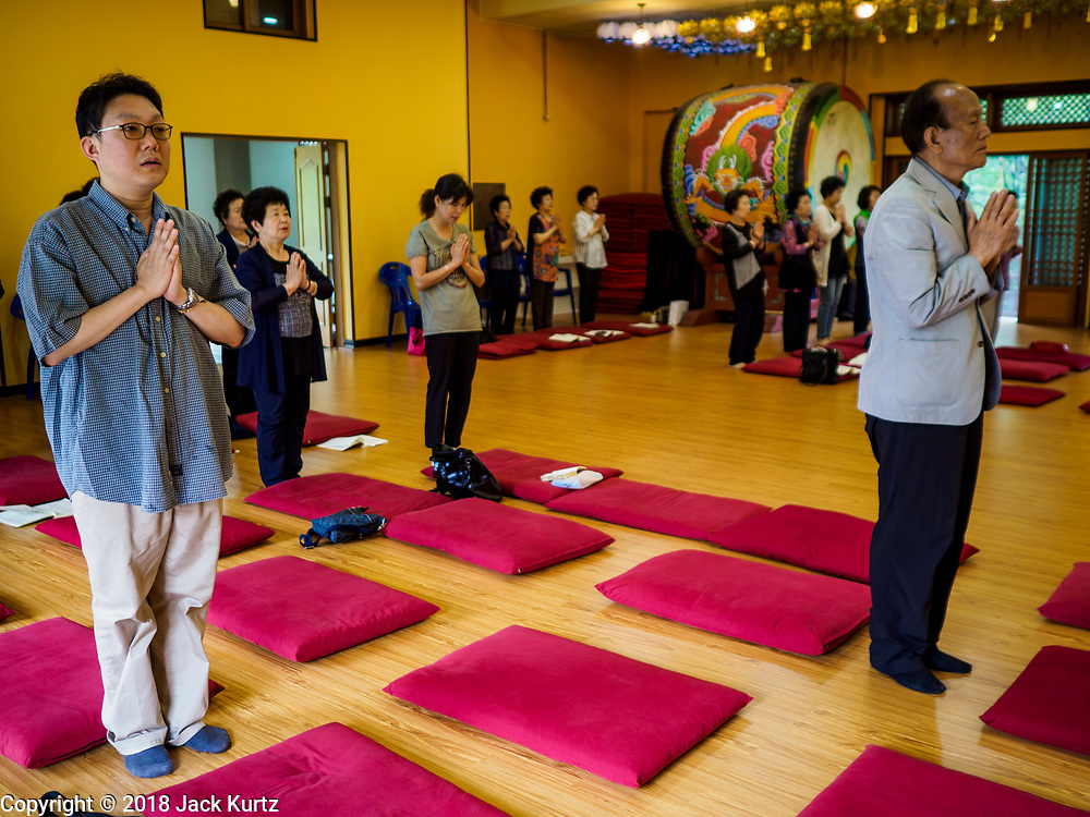 14 JUNE 2018 - SEOUL, SOUTH KOREA: Prayers at Chungjeongsa Temple, a Buddhist temple in Seoul. Koreans practice Tongbulgyo Buddhism, a derivative of Mahayana Buddhism, prevalent in China.       PHOTO BY JACK KURTZ