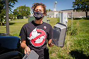 11 AUGUST 2020 - JOHNSTON, IOWA: A member of Black Lives Matter bangs pans together during a protest against Iowa Governo Kim Reynolds. They tried to make enough noise to disrupt one of her press conferences. About 50 members of Des Moines Black Lives Matter picketed the Iowa PBS studios in Johnston Tuesday morning. They went to the PBS offices, about 45 minutes from the State Capitol, to protest against Iowa Governor Kim Reynolds. They want Reynolds to drop charges against or pardon BLM protesters arrested at BLM events this summer and they want her to strengthen and enforce a moritorium on evictions in Iowa.     PHOTO BY JACK KURTZ