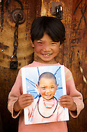 A fun thing I got to do the last time I was in Litang was visit people that I shot portraits of two years earlier and give them back. It was great seeing everyone age two years, especially the kids.