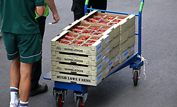 Strawberries are wheeled by staff members on day seven of the Wimbledon Championships at the All England Lawn Tennis and Croquet Club, Wimbledon.