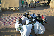 At the end of the month of Ramadan, the Muslim fasting period, some of the families in D'jimia Ishakh Souleymane's block in the Breidjing Refugee Camp celebrated the festival of Eid al-Fitr by banding together to buy a goat, which they then slaughtered. Later that day, the refugee families split up into groups of men and women who feasted, separately, on aiysh and goat-meat soup. (Supporting image from the project Hungry Planet: What the World Eats.)