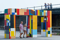 """© Licensed to London News Pictures. 20/07/2021. FOLKESTONE, UK. """"Atsiaƒu ƒe agbo nu"""" (Gateways of the Sea), 2021, by Atta Kwami.  Preview of The Plot exhibition, the fifth Creative Folkestone Triennial. Folkestone has no publicly subsidised art gallery, so artists were invited to use public spaces to create new artworks in the seaside town. Over 20 works by artists including Assemble, Rana Begum, Gilbert & George, Atta Kwami, Pilar Quinteros, and Richard Deacon are on display 22 July to 2 November 2021.  Photo credit: Stephen Chung/LNP"""