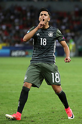 Germany's Nadiem Amiri celebrates scoring his penalty during the shoot-out