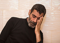 © Licensed to London News Pictures. 17/07/2014. Gaza.   <br /> The father of Ismail Bakir, Mohammed Bakir, one of the four boys killed in an Israeli air strike on a beach in Gaza sits in his house and received condolences from surrounding families.  Photo credit: Alison Baskerville/LNP