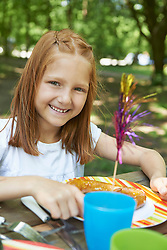 Portrait of a girl eating food at picnic, Munich, Bavaria, Germany