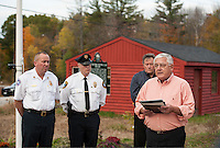 Town Chairman John O'Brien addresses the crowd during the Flagpole dedication at Gilford Outing Club/Warming Hut in honor of first responders on Tuesday afternoon.   (Karen Bobotas/for the Laconia Daily Sun)