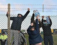 Supplies being passed to lorry drivers stranded at Manston Airfield whilethey wait to travel to France after the border was closed due to the new strain of COVID-19 found in South England photo by <br /> Krisztian Elek