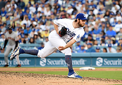 March 29, 2018 - Los Angeles, CA, U.S. - LOS ANGELES, CA - MARCH 29: Los Angeles Dodgers Pitcher Tony Cingrani (54) throws a pitch in the 9th inning during the MLB opening day game between the San Francisco Giants and the Los Angeles Dodgers on March 29, 2018 at Dodger Stadium in Los Angeles, CA. (Photo by Chris Williams/Icon Sportswire) (Credit Image: © Chris Williams/Icon SMI via ZUMA Press)