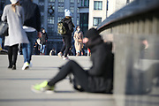 Homeless people in the United Kingdom facing the risk of death from Coronavirus. Last years alone, 320,000 people were recorded as homeless in Britain, analysis from housing charity Shelter suggests. It is a rise of 13,000, or 4%, on last year's figures and equivalent to 36 new people becoming homeless every day.<br /> In this picture, a homeless man is seating at the London Bridge on Sunday, March 22, 2020. For most people, the new coronavirus causes only mild or moderate symptoms, such as fever and cough. For some, especially older adults and people with existing health problems, it can cause more severe illness, including pneumonia. <br /> (Photo/Vudi Xhymshiti)