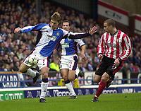 Photo. Glyn Thomas<br />Blackburn Rovers v Southampton. FA Barclaycard Premiership.<br />Ewood Park, Blackburn. 08-02-2003.<br />Blackburn's Garry Flitcroft (L) gets the ball past Danny Higginbotham (R) as Lucas Neill looks on