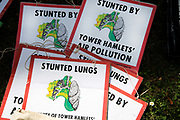 The Air that we Grieve march on July 12th 2019 in East London, United Kingdom. Organised by Extinction Rebellion to draw attention to air pollution and the climate emergency. Placards drawing attention to lungs stunted by air pollution.