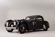 Found in a garage where it had been stored virtually untouched for 50 years, this 1937 Bugatti Type 57s Atalante sports car is previewed for the first time before a Bonhams auction in Paris on February 7th 2009. Here, we see the car in a garage/studio before the auction and sale in Paris. In 2008 the Bugatti Type 57S with chassis number 57502 built in 1937 with the Atalante coachwork for Earl Howe was discovered in a private garage in Newcastle upon Tyne, having been stored untouched for 48 years and known about only by a select few people. It was auctioned in February 2009 at the Retromobile motor show in Paris, France, fetching EUR3.4 million (US$4.6 million), becoming one of the highest valued cars in automotive history, owing much to its extremely low mileage, original condition and ownership pedigree.
