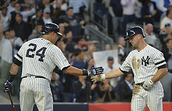 October 18, 2017 - Bronx, NY, USA - The New York Yankees' Brett Gardner celebrates with teammate Gary Sanchez (24) after scoring a third-inning run against the Houston Astros in Game 5 of the American League Championship Series at Yankee Stadium in New York on Wednesday, Oct. 18, 2017. (Credit Image: © Howard Simmons/TNS via ZUMA Wire)