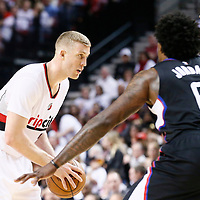 25 April 2016: Portland Trail Blazers center Mason Plumlee (24) looks to pass the ball past Los Angeles Clippers center DeAndre Jordan (6) during the Portland Trail Blazers 98-84 victory over the Los Angeles Clippers, during Game Four of the Western Conference Quarterfinals of the NBA Playoffs at the Moda Center, Portland, Oregon, USA.