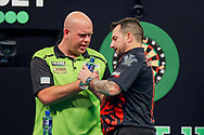 Jonny Clayton and Michael van Gerwen at the end of their match during the PDC Premier League Darts Night 11 at Marshall Arena, Milton Keynes, United Kingdom on 6 May 2021.