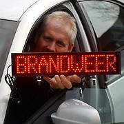Brandweer Huizen gaat over op centraal uitrukken met brandweer bordjes in de auto's, Hans Horstmeijer