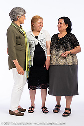 Doyen Mitchell (L) with Aisha Jounou and her sister-in-law Hanifa Jounou at the Intercambio portrait Shoot. Longmont, CO, USA. June 5, 2021. Photography ©2021 Michael Lichter. Usage rights granted to Intercambio Uniting Communities and its assigns.