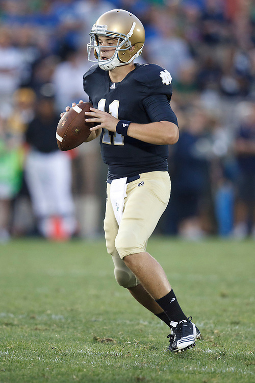 Notre Dame quarterback Tommy Rees (#11) drops back to pass the ball in action during NCAA football game between Notre Dame and South Florida.  The South Florida Bulls defeated the Notre Dame Fighting Irish 23-20 in game at Notre Dame Stadium in South Bend, Indiana.
