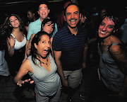 People dancing, partying, and have a good time at Lee Jones's open air Sundae dance party in 2009. This weekly event is held at the the Piazza at Schmidt's in Northern Liberties in Philadelphia each Sunday. Photos in this group are from Sundae Home Grown Pt 1. featuring DJ Lonely, DJ Sean Thomas, and DJ Del.
