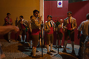 A group of Portugese Forcados stand outside the bullring and show their camaraderie before the evenings bullfight Corrida de Touros, on 15th July 2016, at Caldas da Rainha, Portugal. A forcado is a member of a group of men that performs the pega de cara or pega de caras face catch, the final event in a typical Portuguese bullfight. They were initially professionals from lower classes but nowadays people from all social backgrounds practice their art through amateur groups. In the Portuguese version, unlike Spanish bullfights, the bull is not killed.