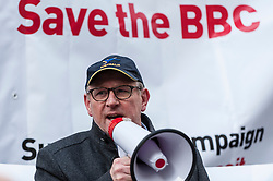 "© Licensed to London News Pictures. 23/11/2015. LONDON, UK. Former Doctor Who actor, Peter Davison, addresses fans of Doctor Who known as ""Whovians"" and other supporters of the BBC gathered outside Broadcasting House in central London to oppose the threat of 20% government cuts to the Corporation which has brought shows such as Dr Who since 1922. Photo credit : Stephen Chung/LNP"