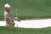 08 April 2009: Trevor Immelman, the defending Masters champion, watches as his bunker shot rolls towards the hole. The final practice round of the 2009 Masters. Players play multiple balls from many different angles in an attempt to master possible reads for tournament days.