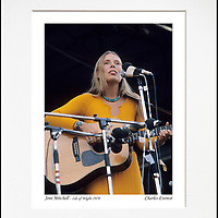 """Joni Mitchell - An affordable archival quality matted print ready for framing at home.<br /> Ideal as a gift or for collectors to cherish, printed on Fuji Crystal Archive photographic paper set in a neutral mat (all mounting materials are acid free conservation grade). <br /> The image (approx 6""""x8"""") sits within a titled border. The outer dimensions of the mat are approx 10""""x12"""""""