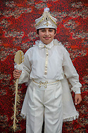 Baris Can Giçi after his traditional circumcision in Sariyer, a town on the Bosphorus coastline north of Istanbul. The boys dress in costumes of Ottoman sultans on the day when they are seen as stepping into manhood.